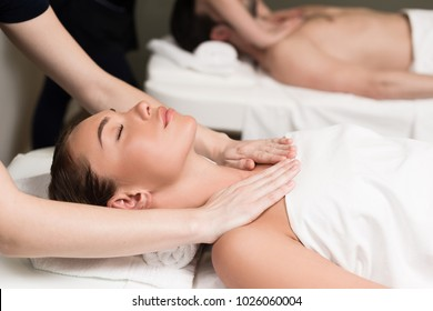 selective focus of couple having massage in spa salon