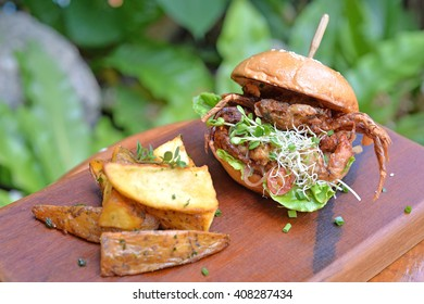 Selective focus of crab burger with chips, fusion food