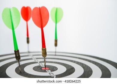 Selective focus of dart arrow hit a center of the target.