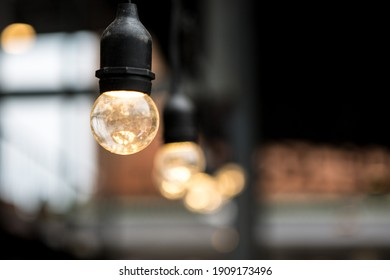Selective focus of Decorative bulbs in cafes on background blurred