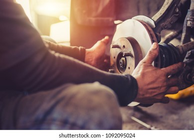 Selective focus disc brake on car, in process of new tire replacement,Car brake repairing in garage