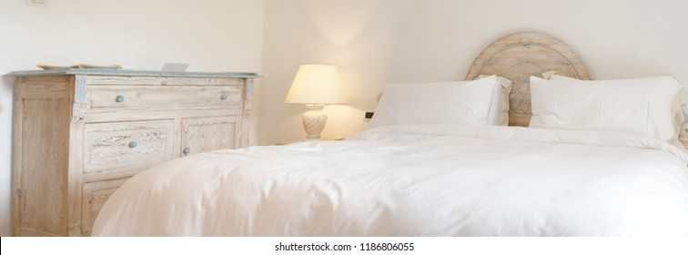 In Selective Focus of Elegant Bed with Soft White Duvet. Bedding and Pillows. Bed Maid-up with Clean white Pillows and Bed Sheets in Beauty Simple Room.High Resolutions  Panorama Images.