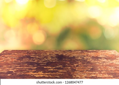Selective focus of empty old wood on blur nature green leaf with bokeh abstract background.