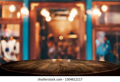 Selective Focus Empty wooden table in front of abstract blurred festive background with night market background bokeh for product montage display of product.