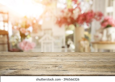 Selective focus empty wooden table or floor on blurred sweet pastel vintage bokeh background.