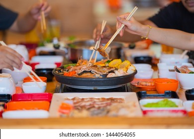 Selective focus Enjoy of Shabu Shabu and Sukiyaki, Japanese food with grill and pot boil