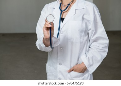 Selective focus of female doctor holding stethoscope.