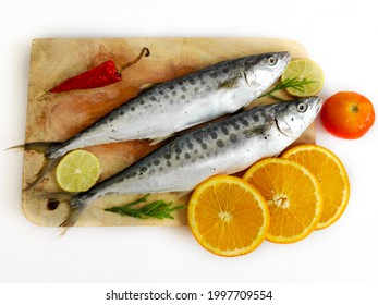 Selective Focus of Fresh Seer Fish,King Fish decorated with herbs and vegetables on a wooden pad.