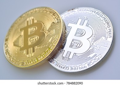 Selective Focus of Golden bitcoins on white background Isolated
