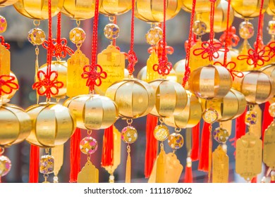 selective focus of golden pray bell at Wen Wu Temple in Taiwan.Group of golden bell with greeting word or lucky word.