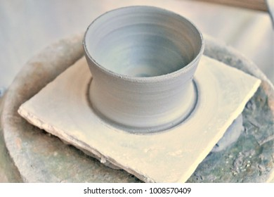 Selective focus gray clay is molded into a container is one of the steps of ancient pottery.
