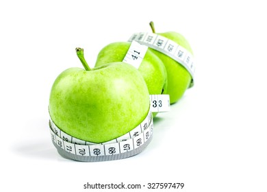selective focus the green apple with Measuring tape on white background in concept of healthy and diet