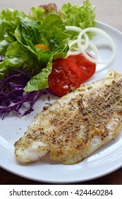 Selective focus of grill fish fillet with herb