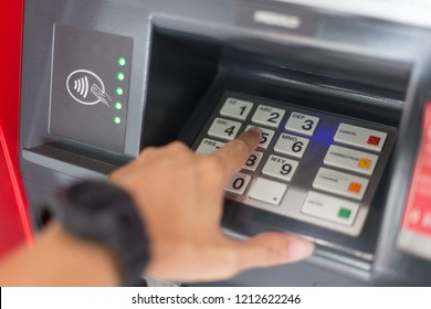 Selective focus of Hand and Keyboard on the ATM