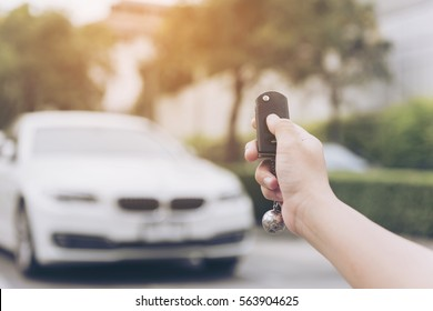 In selective focus of Hand presses on the remote control car alarm systems.