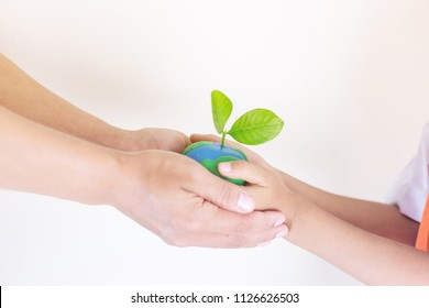 Child world map stock photos images photography shutterstock selective focus hands children and mom holding the world made from clay and tree on top gumiabroncs Image collections