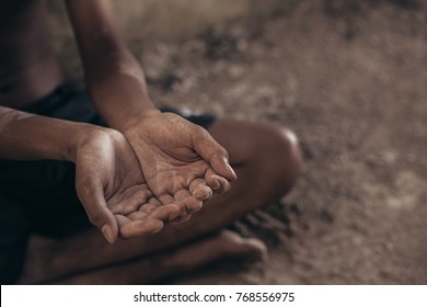 Selective focus. hands poor child begging you for help concept for poverty or hunger people, Human Rights,background text.