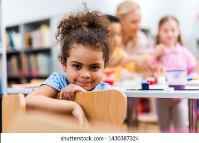 selective focus of happy african american kid looking at camera