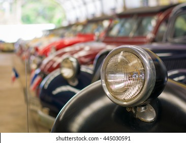 Selective focus headlight lamp vintage car in a row, copy space.