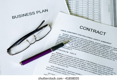 selective focus image of business plan, contract, ballpoint pen and glasses