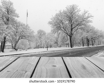 Selective focus image of empty white wooden table with white snow background. / with copy space,black and white image, for display of product or object presentation