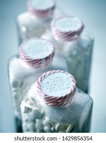 Selective focus image of safety sealed bottles of aspirin pills commonly used as an anti-inflamatory and pain relief medication also to lessen the risk and severity of heart attack