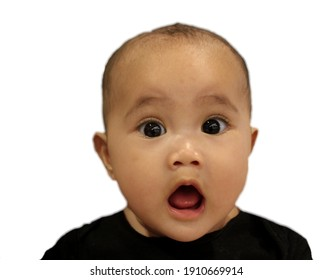 Selective focus image of surprised asian baby open his mouth isolated on a white background