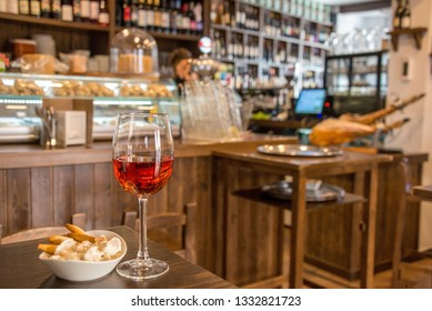 Selective focus image of a wine glass with lid and blurred background of a bar in the city of Ronda, Andalusia, Spain