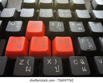 selective focus image,English and Thai alphabets keyboard black color with have red buttons Included.