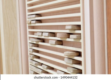 """Selective focus of """"Karbala"""" stone or """"Turbah"""" clay on the shelves in the mosque. It used by Shia Islam for prayer."""