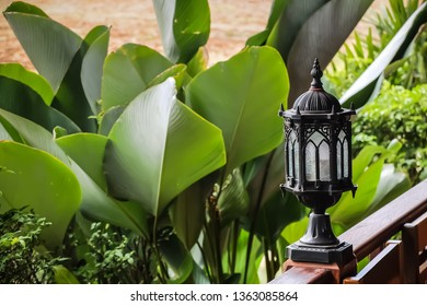 Selective focus of lamp decorative with background of garden view
