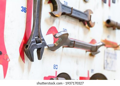 Selective focus layout tools of technician on white wooden board background. silver Tools of construction and engineering for build and fixed.