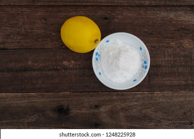 Selective focus, Lemon and Baking soda over the wooden background