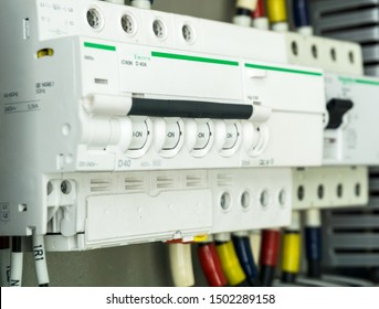 Selective focus of Main Electric circuit breakers with wiring cables in power electric panel box on background.