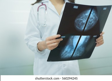 Selective focus Mammogram film image in female doctor hands.