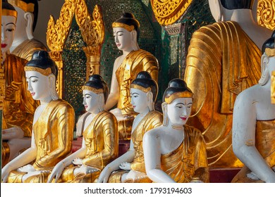 Selective focus. Many statues of sitting Buddha in different sizes at the Shwedagon Pagoda, Shwedagon Pagoda - Myanmar's most sacred Buddhist pagoda