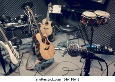 selective focus microphone and blur musical equipment guitar ,bass, drum piano background.