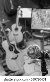 selective focus microphone and blur musical equipment guitar ,bass, drum  lyric stand, background.