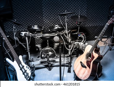 selective focus the  microphone and music instruments the guitar,electric drum,bass,speakers background.