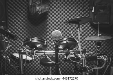 selective focus the microphone and musical instruments the guitar, drum, speakers background. music production band concept.