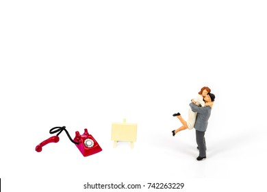 selective focus of miniature couple with phone and board isolated on white , Image for business idea concept
