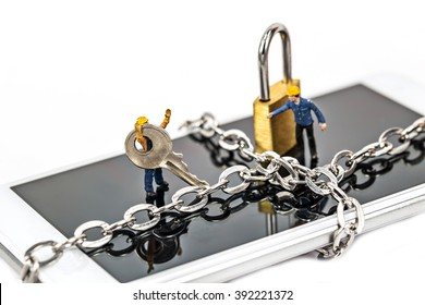selective focus of miniature on smart phone with chain lock,abstract background for solution to security smart phone form not owner.