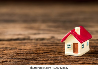 selective focus of miniature tiny home  on wooden floor,  Image for real-estate management  concept.