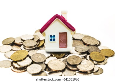 selective focus of miniature tiny home on stack coins with  over chart  and blurred airplane background,  Image for real-estate management  concept.