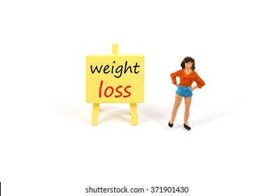 selective focus of miniature woman with inspiration board isolated on white, abstract back ground to solution for health and weight loss.
