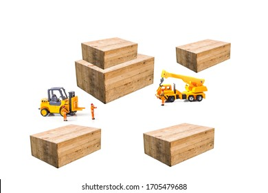 Selective focus of miniature worker people, working  front of forklift machine with wood box on white background