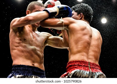 Selective focus The muay thai Boxers fight on stage.