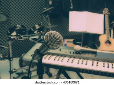 selective focus music background the microphone and blur musical equipment guitar ,bass, drum piano background.