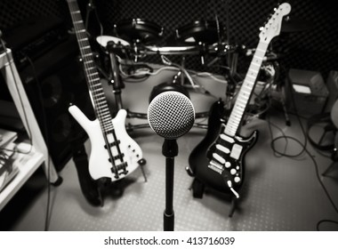 selective focus music instrument the microphone, electric guitar,drum,bass.