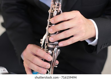 Selective focus of musicians, blurred of clarinet for background.